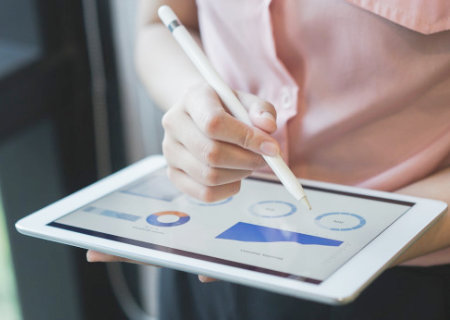 Charts and graphs displayed on a tablet.