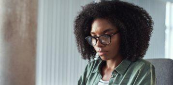 Confident Female Designer Working On A Digital Tablet