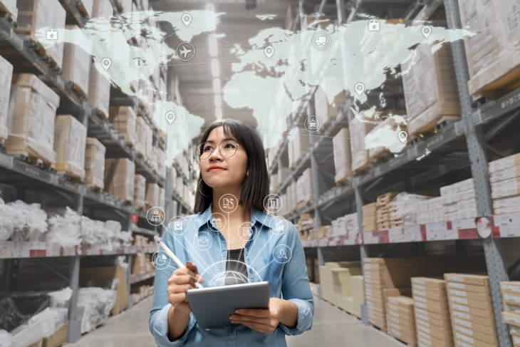 Looking At Inventory In Warehouse Using Smart Tablet In Management Technology, Interconnected Industry, Asian Small Business Sme Concept.